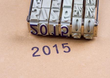 printery: 2015 printed with an inkpad on a brown cardboard