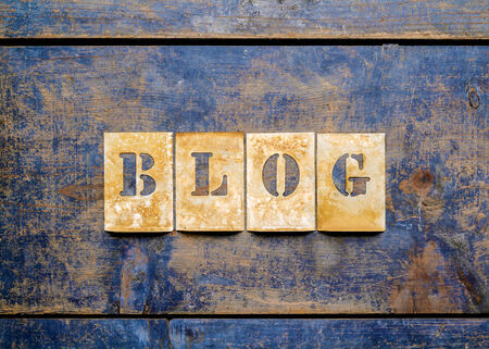 printery: Metal lettering over a weathered wood background showing the word \BLOG\ Stock Photo