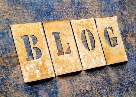 typesetting: Metal lettering over a weathered wood background showing the word \BLOG\ Stock Photo