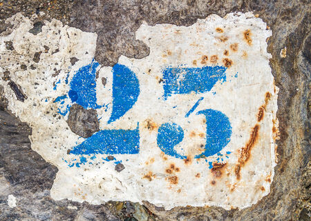 sort out: Number 23 painted on the ground of the quay, to identify the mooring of each boat