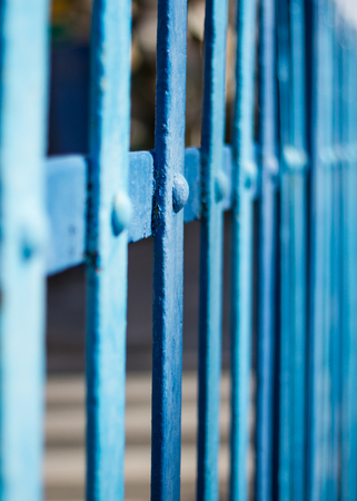 standpoint: Perspective view of a fence with blue metal slats