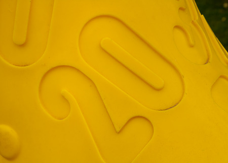 fount: Number 20 engraved on the plastic surface of a toy Stock Photo