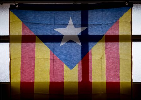 separatist: Starry flag the Catalan secessionist emblem hanging on a window