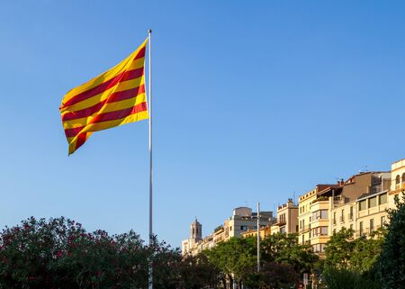 photojournalism: Catalan flag waving in the main square of the city of Girona Catalonia