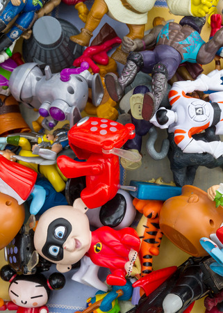 Barcelona, Spain - September 26, 2010 : a pile of used dolls at flea market Editorial