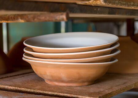 craftwork: Dishes sorted in a ceramist workshop