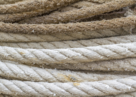 fishing gear: Close-up of the ropes of a trawl fishing gear stacked in the harbor.