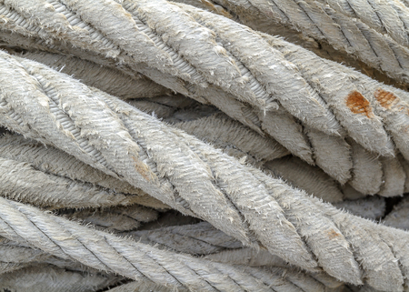 fishing gear: Ropes of a trawl fishing gear stacked in the harbor.