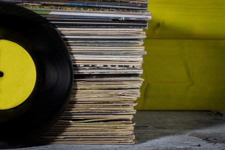 Records Stacked, One in Front