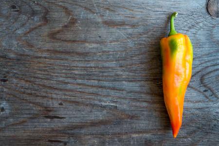 kilos: Pepper on Wooden Background
