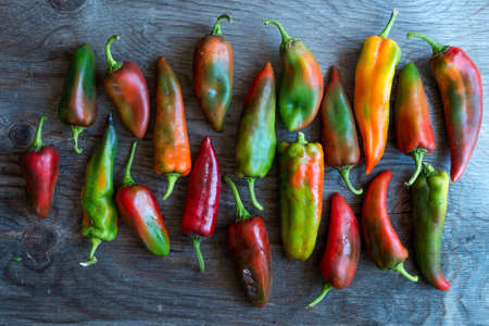 kilos: Peppers on Wooden Background