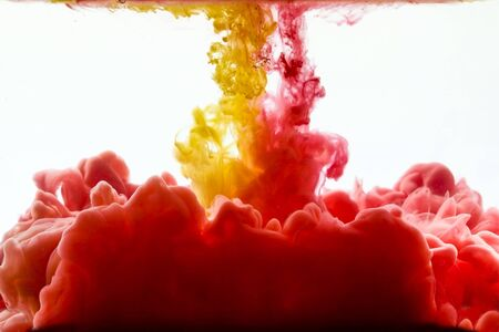 dissolve: Multicolored swirling drop of ink in water creates abstract backgrounds