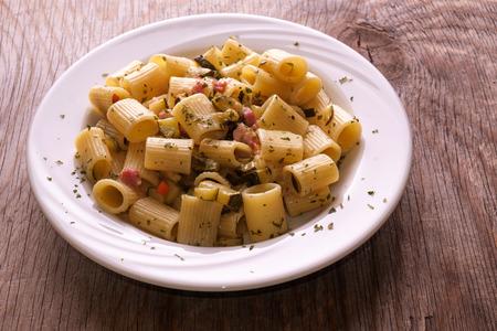 Rigatoni pasta with pancetta and zucchini