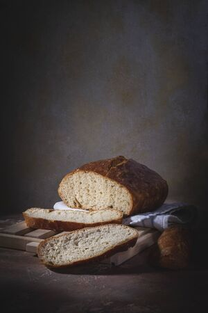 Homemade bread laid on a rustic table in a vintage setting