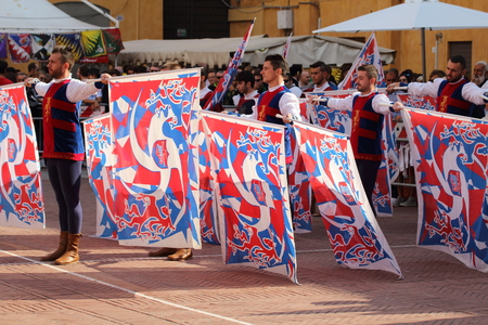 aspects: Ferrara, Italy - 13 september 2015 - Duel gold, Duel golden. It a national competition among the flag bearers of all Italy in historical. Flag wavers are typical aspects of a town that has over a thousand-year old history.
