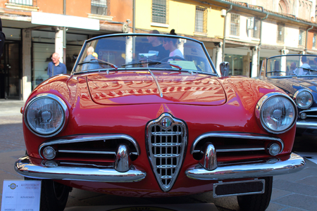 alfa: Ferrara, Italia - September 24, 2016: The event AutoMotoStoriche in Old Town you can admire an exhibition of cars and motorcycles in the historic center of Ferrara. Front of Alfa Romeo Giulietta