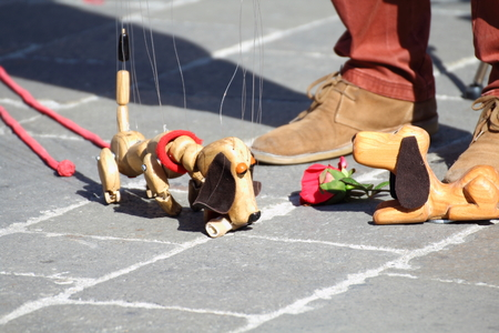 Traditional puppets made of wood. Puppet to form of dog moved by man. Stock Photo