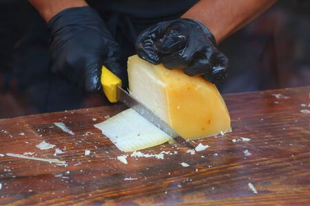 Country festival. The cook prepares a sandwich with ham and seasoned cheese Banco de Imagens