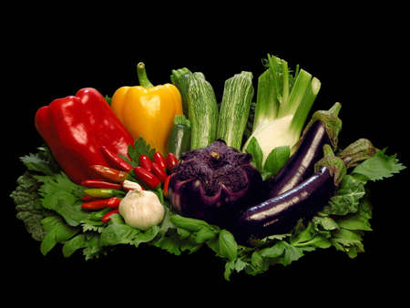 Colorful fresh group Of vegetables on black background photo