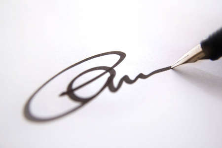 Business signature of approval, black ink on white paper close up, depth of field  Stock Photo