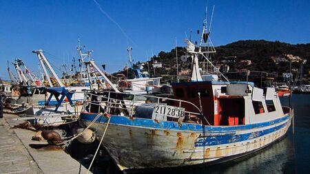 Fishing Boats in a Harbour and a Blue Sky Stock Photo