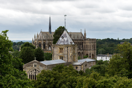 ARUNDEL, ENGLAND, UK – AUGUST 11 2018: View of The Parish and Priory Church of Saint Nicholas taken from The Keep of Arundel Castle with Arundel Cathedral in the background.