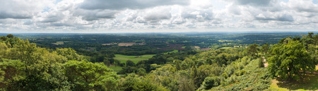 Panoramic view of the Surrey and Sussex countryside from the North Downs to the South Downs in England, UK. Taken from the top of Leith Hill Tower on a cloudy summer's day.