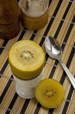 eggcup: Golden Kiwi fruit in an eggcup