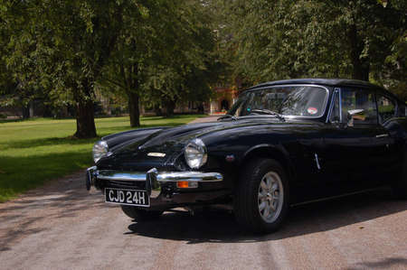 carburettor: British classic sports car 1960s 60s black Triumph GT6 Spitfire