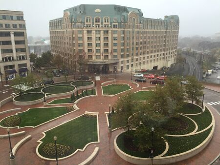 City buildings and park on foggy day