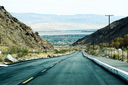 Palm Springs CA-Road in a desert Stock Photo
