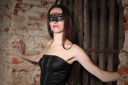 Girl in ornate mask photo