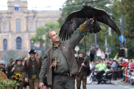 golden eagle: A man with a Golden Eagle taking part in the annual Traditional costume parade on the first weekend of Oktoberfest in Munich, Bavaria on the 20th Sept 2015