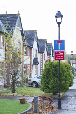 Children playing slow care sign in residential houses development