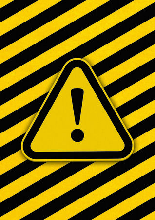 Hazard triangle with diagonal black and yellow lines in background  Stock Photo