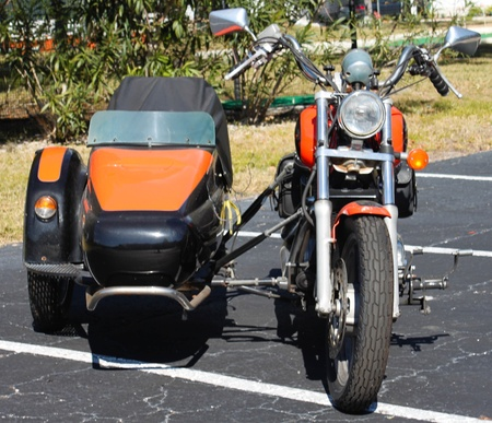 sidecar: Black and orange motercycle with sidecar