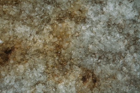 Marble untreated wall with irregularities and cracks. Texture, background