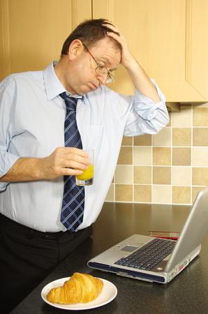 bussiness man: Business man having a stressful working breakfast