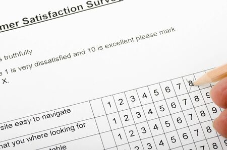 completing: Completing a feedback Survey Stock Photo