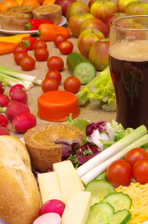 typically english: Typical English Ploughmans Lunch. Bread pork pie and a salad selection Stock Photo