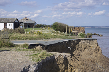 coastal erosion: Coastal erosion on the East Yorkshire coast in England. This is one of the fastest eroding coastlines in Europe. It continues to see properties and roads disappear at an alarming rate. Stock Photo