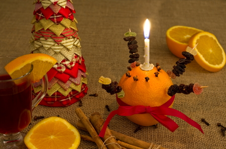 but: A freshly made Christingle table display, related to advent, it originates in Germany from the C18th.  but has spread across Europe and the Christian world.