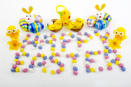 color photographs: Mini Easter eggs spelling the words Happy Easter with a selection of Easter Duck and Rabbit  novelties.