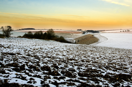 chalky: Early morning light on the Yorkshire Wolds partly covered by snow, showing the very chalky land. Stock Photo
