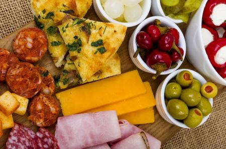Antipasto Sharing Platter,  A large wooden sharing platter of Antipasto. Stock Photo