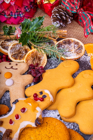 Selection of festive decorated Christmas Gingerbread characters surrounded by presents and gifts.