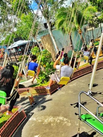 theme park: People having fun at a theme park Stock Photo