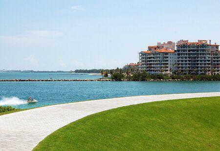 condos: Miami Beach Lifestyle -Parks-Jetskis-Luxury Condos Stock Photo