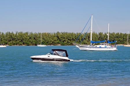 intercoastal: Motorboat and Schooner on the Intercoastal Stock Photo