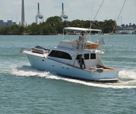well equipped: Well equipped sport fishing boat cruising on the florida  inter coastal